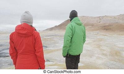 Iceland tourists at volcano mudpot hot spring landmark destination: Namafjall Hverarondor hverir mudpot also called mud pool hot spring or fumarole. Beautiful Icelandic nature. RED EPIC SLOW MOTION.
