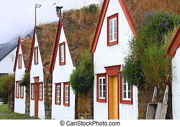 Iceland - typical rural turf houses. Old architecture with...