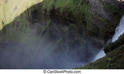 Iceland, view of Skogafoss waterfall, pan. View from the top...