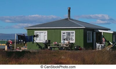 Icelanders live in a green house in a small town. Andreev.