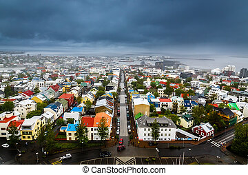 Icelandic capital panorama, streets and colorful resedential buildings with fjord and mountains in the background, Reykjavik, Iceland