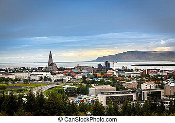 Icelandic capital panorama, streets and resedential buildings with fjord and mountains in the background, Reykjavik, Iceland