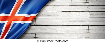 Icelandic flag on old white wall banner