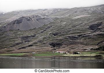 Icelandic Landscape: Farm in Foggy Mountains