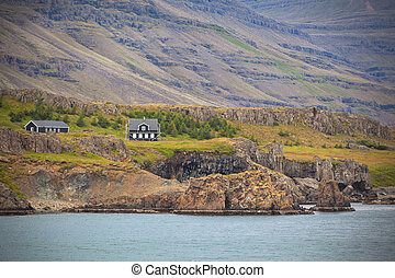 Icelandic Landscape: Houses in Foggy Mountains