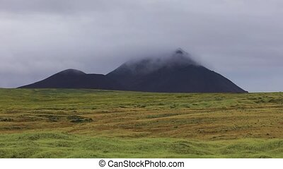 Icelandic landscape with a mountain covered with cloud....