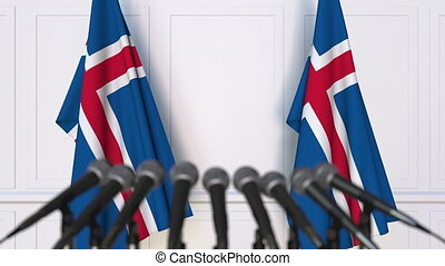 Icelandic official press conference. Flags of Iceland and...