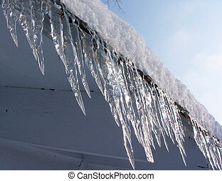 Close up photo of icicles on rooftop