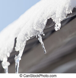 Icicles from the roof of the house