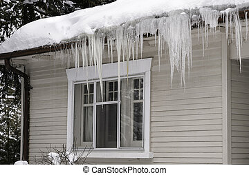 Icicles Hanging from House Eaves