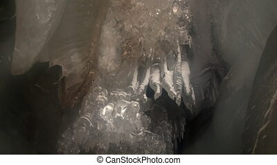 Icicles in cave Svalbard Arctic. Hollow place in in glacier....