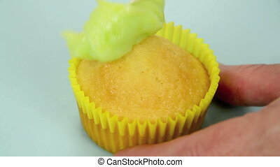 Icing A Single Cup Cake - Icing and adding hundreds and...