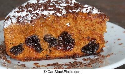 Icing sugar generously sprinkles homemade freshly baked cake...