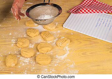 Icing sugar on cookies - Icing sugar being