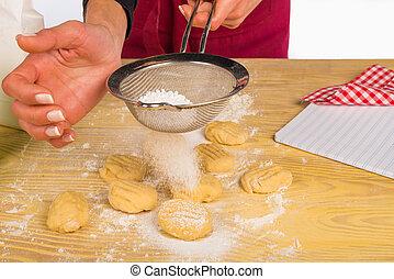 Icing sugar - Powdering icing sugar on freshly made cookies