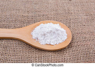 Icing Sugar - White refine sugar in wooden spoon on gunny ...