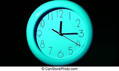 Icon of  blue clock with shadow on black background