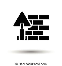 Icon of brick wall with trowel. White background with shadow design. Vector illustration.