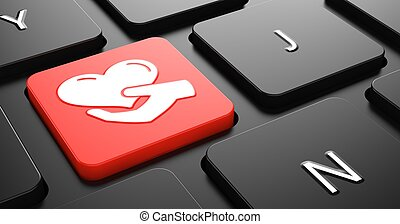 Icon of Heart in the Hand on Red Keyboard Button.