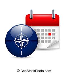 Icon of NATO flag and calendar - Calendar and round NATO...
