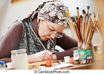 icon painting process - iconography. painter woman paints a...