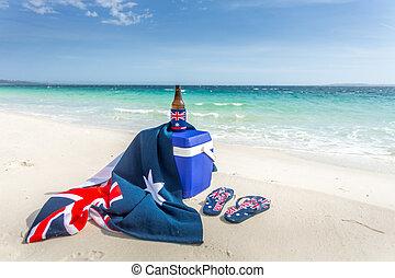 Iconic Australian items on a beach, esky, beach towel, beer...