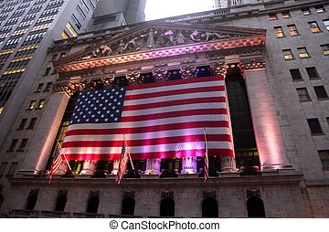 Iconic building of New York Stock Exchange at dusk , with lights on