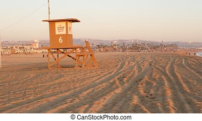 Iconic retro wooden orange lifeguard watch tower on sandy ...