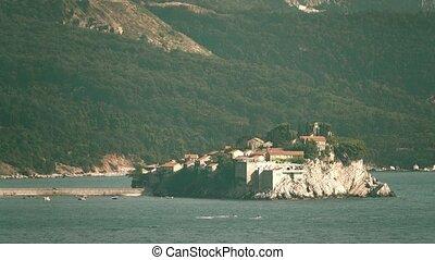 Iconic telephoto shot of famous island village Sveti Stefan...