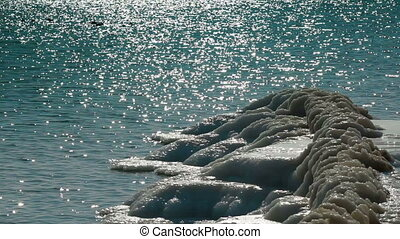 Icy Coastline - ice in foreground and open water in...