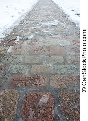 cobblestone pavement - icy cobblestone pavement in winter