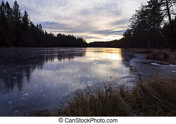 Icy fresh water lake in the sunset