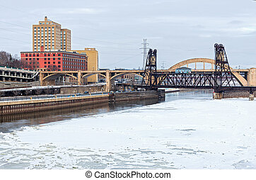 Icy mississippi river and bridge