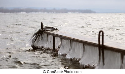 Icy pier on the river in the spring - Icy pier on the river...