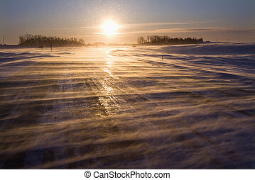 Icy road at sunrise. - Ice covered road with sun rising in...