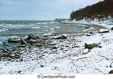 icy sea rocks and shore, winter landscape on the sea
