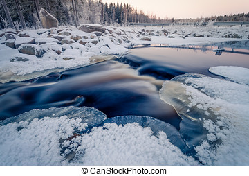 Icy Stream on the River - Beutiful colors of the sunset on...