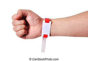 ID bracelets of a hand adult man patient