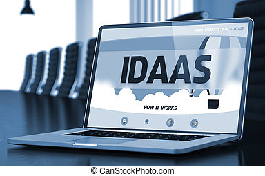 Idaas on Laptop in Conference Hall. 3D.