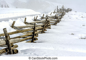 Idaho country road in winter with pole fence