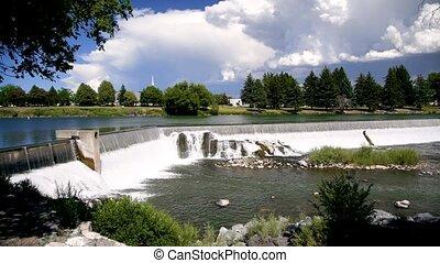 Idaho Falls, Idaho. River and city waterfalls on a beautiful summer day.