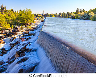 Idaho Falls, Idaho - JULY 1, 2012: The small waterfall on Snake River is a part of Power Hydro Electric project in Idaho Falls.