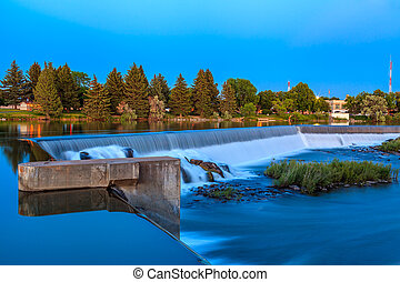 Idaho Falls, Idaho - JUNE 30, 2012: The small waterfall on Snake River is a part of Power Hydro Electric project in Idaho Falls.