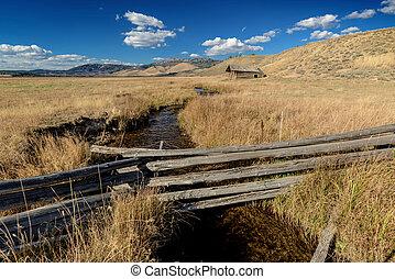 Idaho farm field with Log Cabin