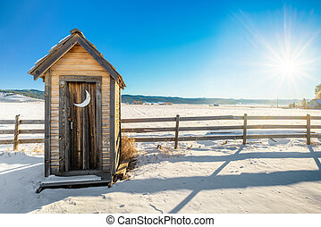 Idaho outhouse in the winter - Rustic old outhouse on a snow...