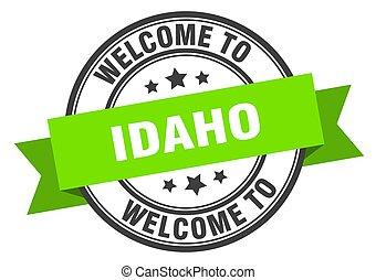 Idaho stamp. welcome to Idaho green sign