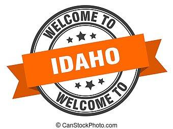 Idaho stamp. welcome to Idaho orange sign