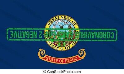 Idaho US state swaying flag with green grunge stamp of freedom from coronavirus, loop
