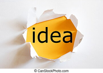 idea on yellow background in a paper hole