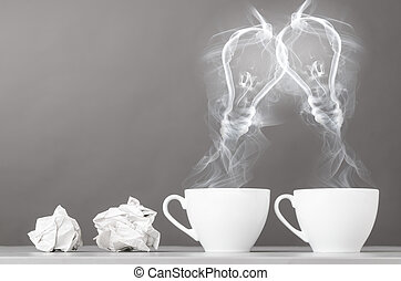 idea birth - creating idea. bulbs silhouette from steaming...